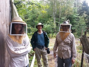 Nicole and Paul suit up for a lesson in beekeeping while Terry helps coach.